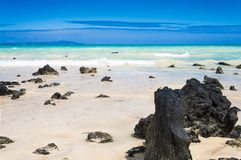 Galapagos sea view. Typical Galapagos beach with white sand, emerald sea and volcanic rocks. El Garrapatero beach, Santa Cruz, Galapagos Islands Royalty Free Stock Photo