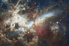 Galassia incredibilmente bella molti anni luci lontano dalla terra Elementi di questa immagine ammobiliati dalla NASA fotografia stock