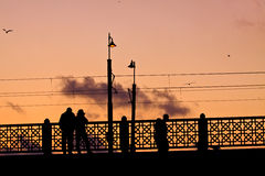 Galata Bridge in Istanbul at sunset with people on the bridge, p Royalty Free Stock Photo