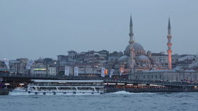 Galata Bridge and mosque Eminonu ( New Mosque) in the evening. stock video