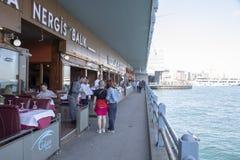 Galata Bridge restaurants and people eating stock photo