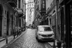 Istanbul and daytime I. Galata district, Istanbul Turkey, March 15, 2018, daytime life in one of the streets of the Galata district, in the background the galata Stock Images
