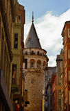 Galata Tower, Istanbul. A view of the medieval stone Galeta Tower through the buildings in an Istanbul, Turkey neighborhood Stock Photos