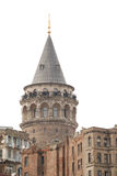 Galata Tower, Istanbul, Turkey. Famous Turkish landmark, isolated from sky, people's faces blurred Stock Images