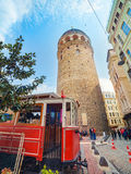 Galata tower and old red tram in Istanbul, Turkey. Stock Image