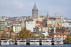 Galata Tower and ships at Karakoy pier in Istanbul, Turkey Stock Images