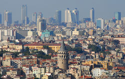 Galata tower and skyscraper. Modern istanbul buildings behind old Galata tower in Turkey Stock Images