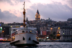 Galata Tower and steamboat Royalty Free Stock Images