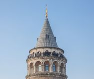 Galata Tower with tourists against blue sky Stock Images