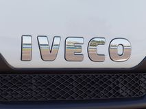 Iveco Sign in front of a van. GALATI, ROMANIA - SEPTEMBER 20, 2016. Iveco Sign in front of a van on an outdoor exhibition. Iveco, Industrial Vehicles Corporation stock image