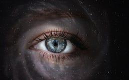 Galaxia con el ojo imagen de archivo