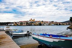 Galaxidi, Greece, View Across Outer Harbour. Fishing boats moored in the outer harbour, Galaxidi, Greece, with view across the sea water to the main town, with stock images