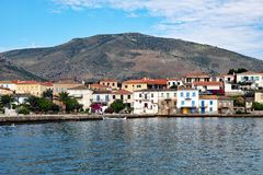 Galaxidi, Greece, View Across Outer Harbour. View across the outer harbour, Galaxidi, Gulf of Corinth, Greece, to the Eastern part of the town, with a mountain stock photo