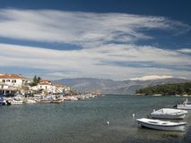 Galaxidi Town Sea-Front. The sea-front of the historic town of Galaxidi, Greece, in the early springtime; in the background, the snow-capped mountain of stock photo