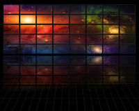 Galaxies and stars on screens in dark space Royalty Free Stock Photos