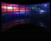 Galaxies and stars on screens in dark space Royalty Free Stock Photo