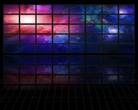 Galaxies and stars on screens Royalty Free Stock Images