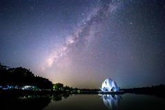 The galaxy and the building are shaped like a white lotus in the middle of the river. royalty free stock image