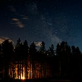 Galaxy and a Camp Fire. Rocky Mountain National Park Camp Ground Stock Photo