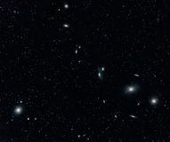 Galaxy Cluster in Virgo. Markarian's Chain Galaxy Cluster in Virgo captured with an amateur telescope vector illustration
