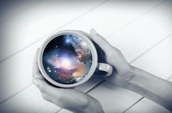 Galaxy in the cup Stock Photos