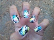 Galaxy nail art. Galaxy nails wow Royalty Free Stock Images