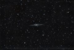 Galaxy NGC 891. Image taken with Visac Vixen telescope of 8 inches. In total 4 hours of exposure. This spiral galaxy is far from us 32 million light years, is royalty free stock photography