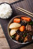 Galbi jjim Korean Braised Beef Short Ribs with rice close-up. vertical top view royalty free stock photography