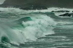Gale and Big Swell Bring Large Waves to Oregon Coast. Among Rocks Stock Photography