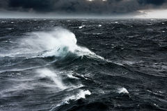 Gale. Waves Breaking and Spraying at High Seas and Strong Winds Stock Photography