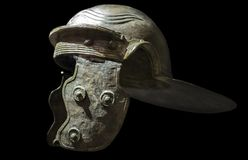 Galea or Roman soldier helmet. Isolated over black. Madrid, Spain - November 11, 2017: Galea or Roman soldier helmet. National Archeological  Museum of Madrid Stock Images
