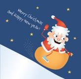 Galen jultomten som ner sledding Arkivbild