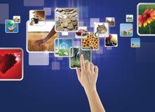 Galerie de photos sur l'écran tactile Photographie stock libre de droits