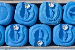 Galões azuis Fotografia de Stock