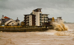 The gales in Weston-super-Mare on 8th June 2012. This photo shows waves breaking over Knightstone Island, a residential building on the sea front Stock Image