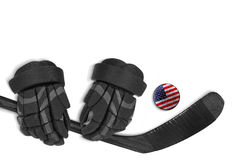 Galet, gants et bâton de hockey américains Images stock