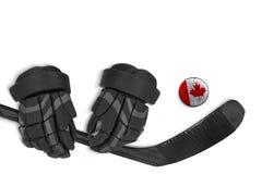 Galet, gants et bâton de hockey canadiens Image libre de droits