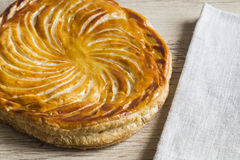 Galette des Rois. (also known as Epiphany Cake or King's Cake) with a napkin Stock Photography