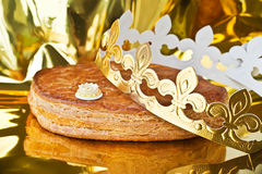 Galette des rois, french kingcake with a golden crown. Galette des rois, french king cake with a golden crown Stock Photos