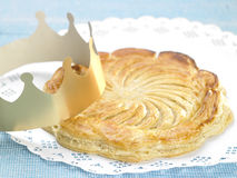 Galette des rois and paper crown Royalty Free Stock Photography