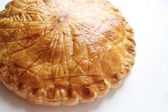 Galette des rois traditional puff pastry pie with celtic runes royalty free stock photo