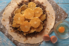 Galette dough with walnuts and orange Stock Photo