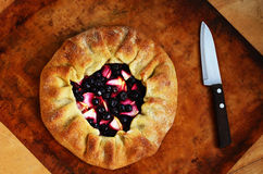 Galette or open pie with apples and berries, on baking sheet Royalty Free Stock Image