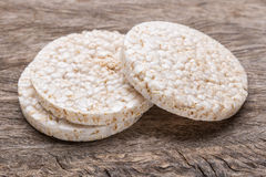 Galette rice with few calories. On wood texture stock images
