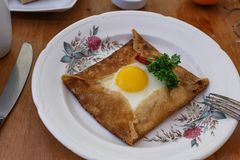 Galette sarrasin, buckwheat crepe, with ham cheese and egg, french brittany cuisine.  stock photo