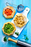 Galettes with fruits. Assorted open-faced simple rustic pies or galettes with fresh fruits Stock Images