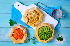 Galettes with fruits. Assorted open-faced simple rustic pies or galettes with fresh fruits Stock Photography