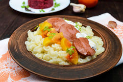 Galetti Pasta with pieces of sausage, yellow tomatoes Royalty Free Stock Images