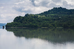 Gali reservoir Abkhazia. The reflection of the forest in water of the Gali reservoir royalty free stock image