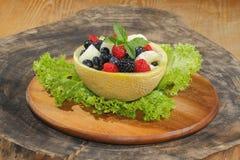 Galia melon, cantaloupe, raspberries, blackberries, blueberries Stock Images